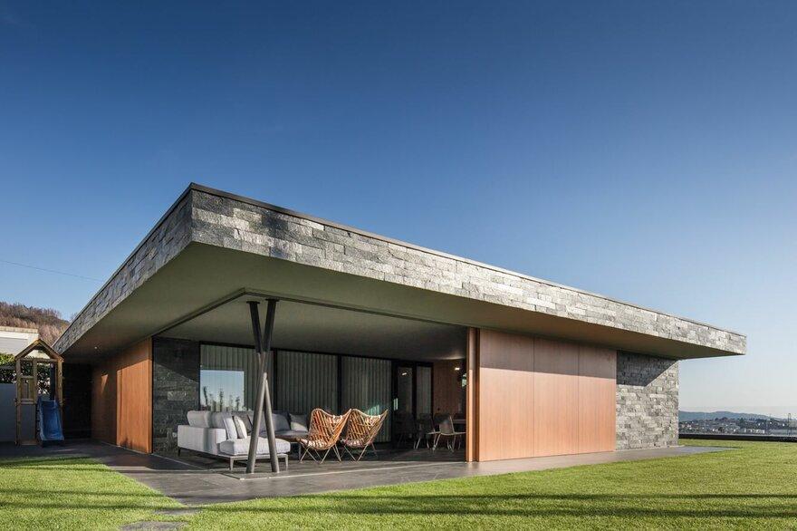 V-Shaped Concrete House by TRAMA arquitetos in Braga, Portugal